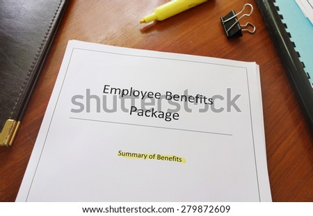 Employee Benefits Package document on an office desk                                - stock photo