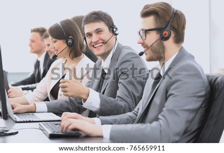 employee call center with headset showing thumb up