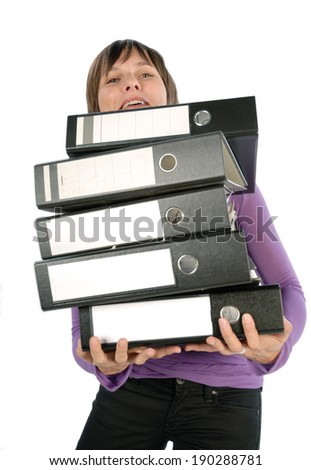 Employee carrying a heavy pile of documents. - stock photo