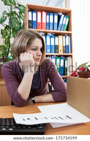 Employee dismissal at work, with white sheet of paper with fired word - stock photo
