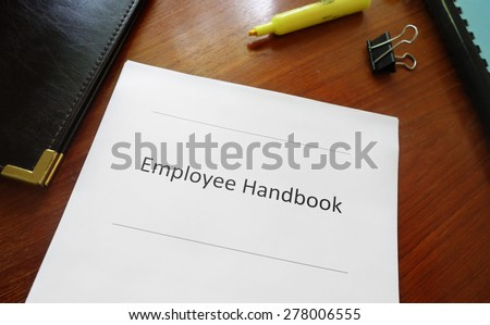 Employee handbook document on an office desk                                - stock photo