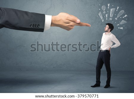 Employee in trouble getting last warning from boss concept with big business hand pointing at salesman and drawn exclamation marks - stock photo