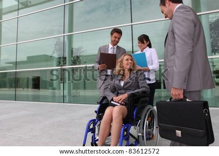 employee in wheelchair - stock photo