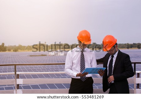 Employee reporting of performance solar power to business owner.concept of working in solar cell company.