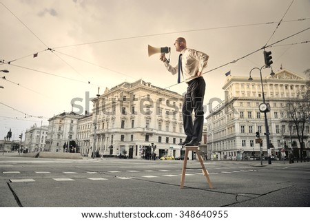 Employee screaming into a megaphone - stock photo