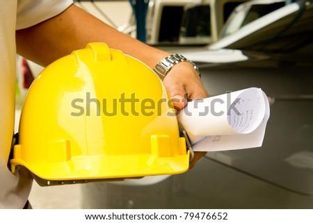 Employees and helmet - stock photo