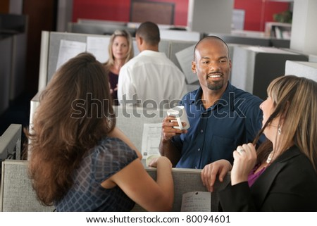 Employees enjoying cup of coffee during break - stock photo