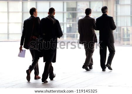 Employees going against the office. Panorama. A group of businessmen.