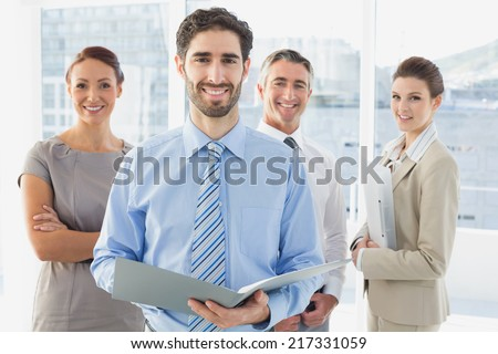 Employees having a business meeting in a conference room - stock photo