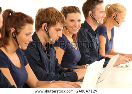 employees in the call center - stock photo