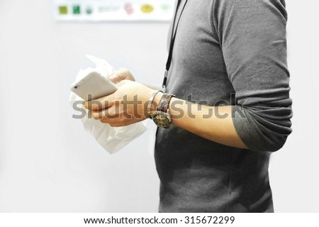 employees man using phone in office,using mobile smart phone, Internet of things lifestyle with wireless communication and internet with smart phone. technology and lifestyle.  - stock photo