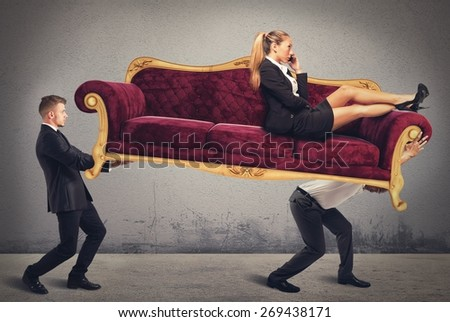 Employees raise and carry their woman leader - stock photo