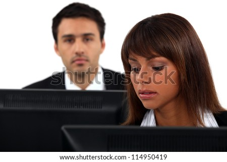 Employees sitting in front of their computers - stock photo