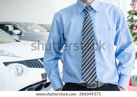 Employees Standing in front of car and Gift boxes background - stock photo