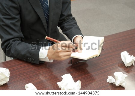 Employees writing notes