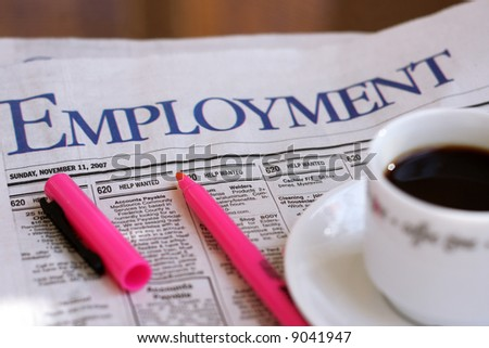Employment adds , marker and cup of coffee