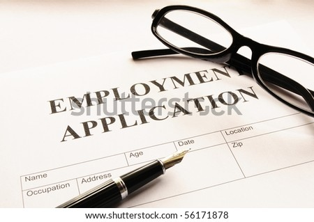 employment application form on desk showing job search concept - stock photo