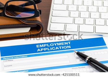 employment application form pen keyboard document stock photo