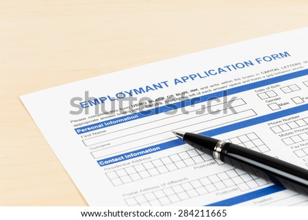 Employment application form with pen concept job applying - stock photo