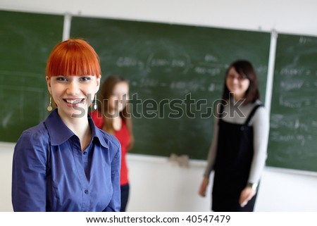 Employment at students in the higher school near a blackboard - stock photo