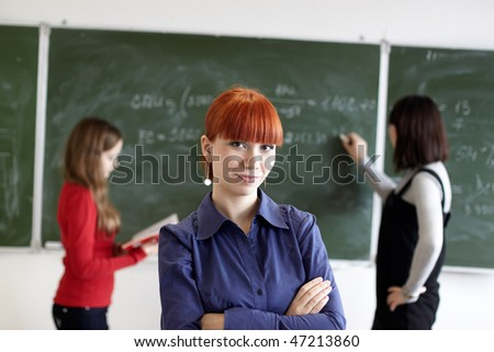 Employment at students in the higher school near a blackboard