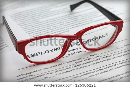 employment contract and female red glasses, close-up - stock photo