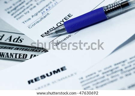 Employment contract ready to sign and resume with ads in the background. - stock photo