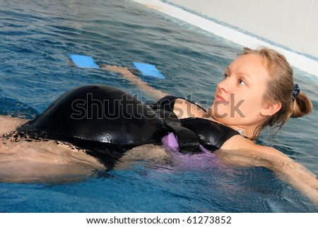 Employment pregnant women small pool stock photo 61273852 shutterstock for Girl pregnant in swimming pool