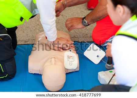 Empoli, Italy - 07 May 2016: The event is run in the square, doctors, nurses and volunteers welcome high school students for a course of first aid, also emergency vehicles on show.