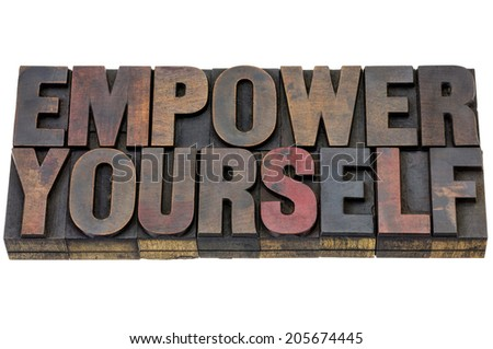 empower yourself - motivation concept - isolated text in vintage letterpress wood type blocks stained vy ink - stock photo