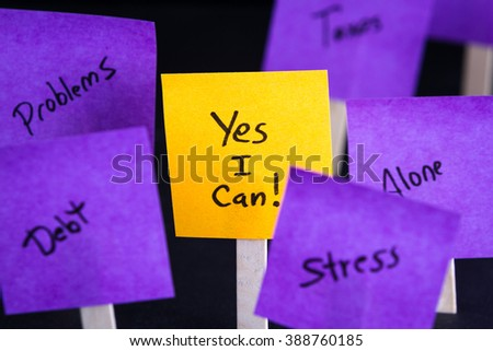 empowering concept image with yes I can written on a sticky note with other negative thought fading out of focus - stock photo