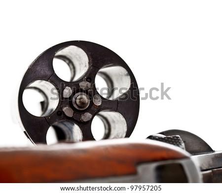 emptied storage cylinder of revolver handgun - stock photo