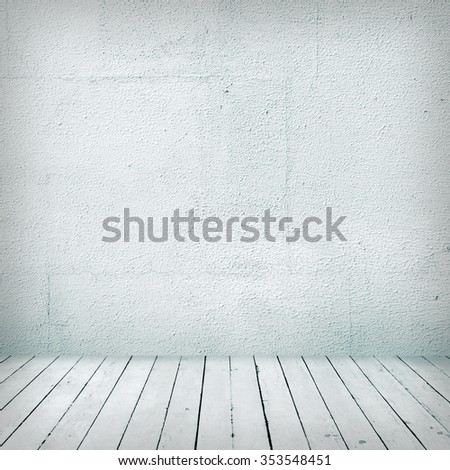 Empty a white Interior of vintage room without ceiling from gray grunge stone wall and old wooden floor. - stock photo