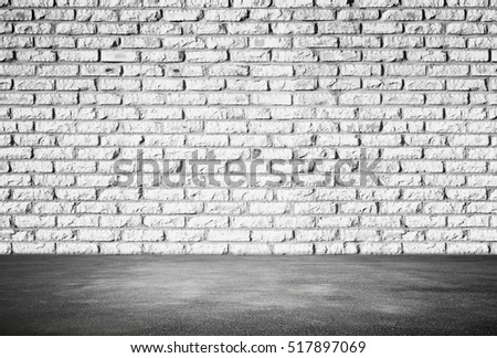 Empty abstract interior background with white brick wall and gray asphalt floor