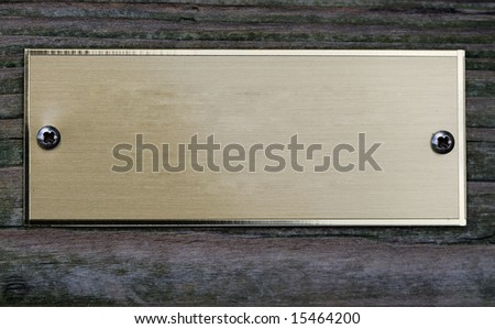 empty aged metal plate on wooden door