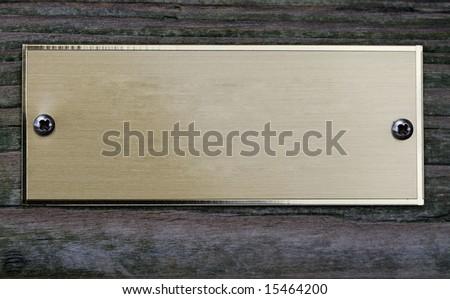 empty aged metal plate on wooden door - stock photo
