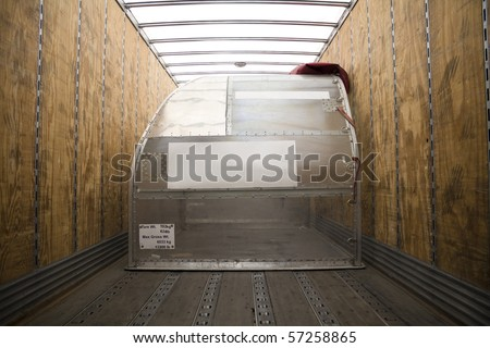 Empty Air Freight Container inside Truck - stock photo