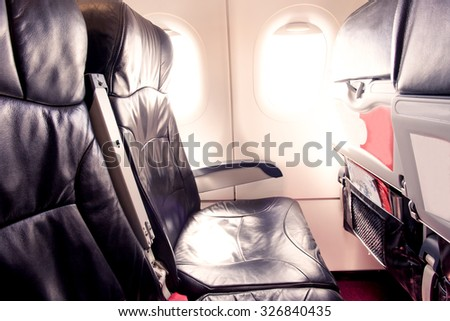 Empty airplane seats and window in the cabin