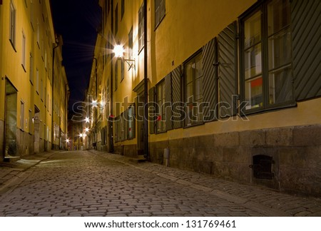Empty alley at night. - stock photo