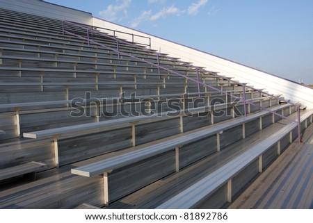 Empty American Football Field Bleachers - stock photo