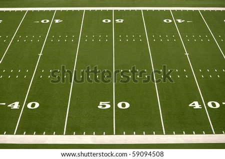 Empty American football field showing 40 and 50 yard lines - stock photo