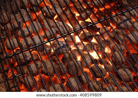 Empty And Clean BBQ Grill Pit With Glowing Hot Charcoal Briquettes In The Background, Close-Up, Top View. Concept For Outdoor Barbecue Party Or Picnic Or Cookout - stock photo