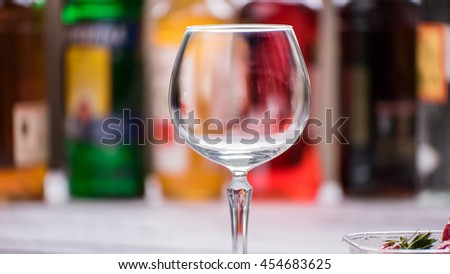 Empty and clean wineglass. Glass on blurred background. Welcome to the bar. Drink anything you want. - stock photo
