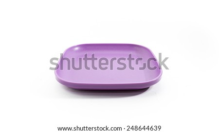 Empty and colourful luncheon plastic square luncheon food plates. Isolated on white background. Copy space. - stock photo
