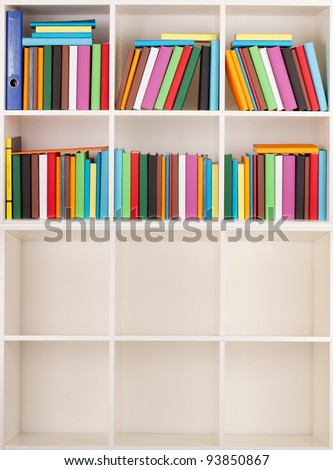 Empty and full Bookcase library - stock photo