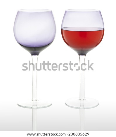 empty and full wine glasses isolated on white background. (with PS paths) - stock photo