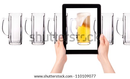 empty and one full beer on tablet computer screen  isolated on a white background