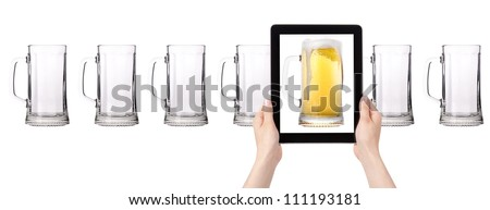 empty and one full beer on tablet computer screen  isolated on a white background - stock photo