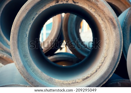 Empty and unused sewage pipes close up, pattern and industry background - stock photo
