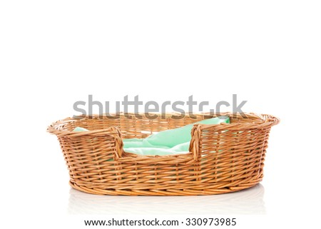 empty animal bed with green blanket isolated over white background - stock photo